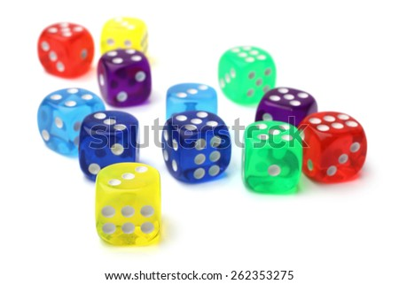 Many-colored dice set on white background - stock photo