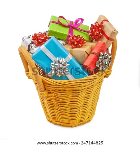 Many colored gift boxes in a basket isolated on white background - stock photo