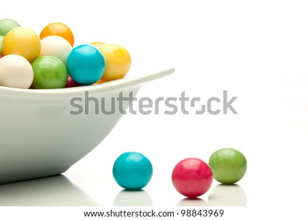 many colored gumballs on a white background - stock photo