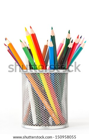 many colored pencils in a holder before white background - stock photo