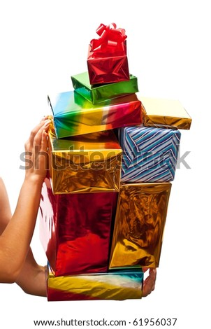 Many colored presents in woman's hands. Isolated on white - stock photo