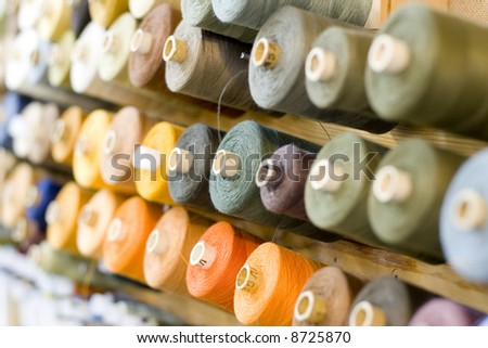 many colored threads soft focused - stock photo