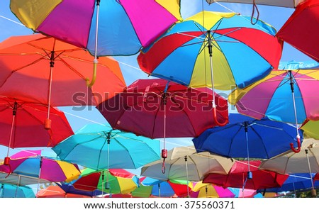 many colored umbrellas - stock photo