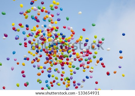 Many colorful balloons flying in the air - stock photo