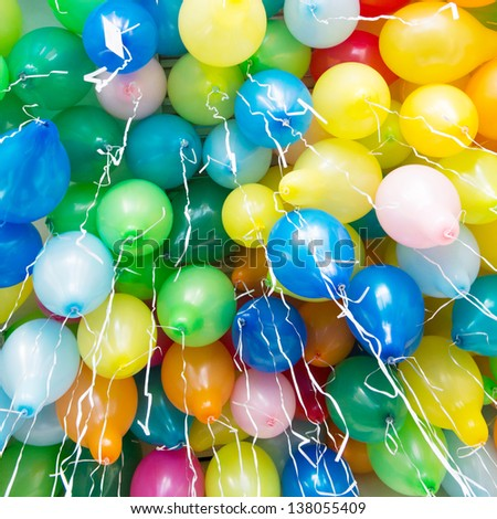 Many colorful balloons with ribbons - stock photo
