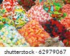 many colorful candies on market stand - stock photo