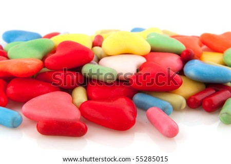 Many colorful candy hearts isolated over white