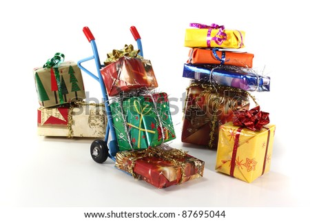 many colorful Christmas presents on a hand truck