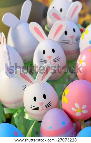 Many colorful designed easter eggs and bunny toys - stock photo