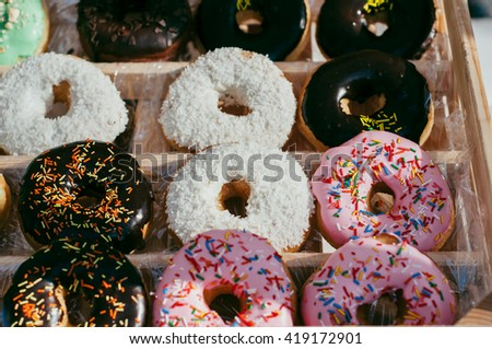 many colorful donuts assorted  background