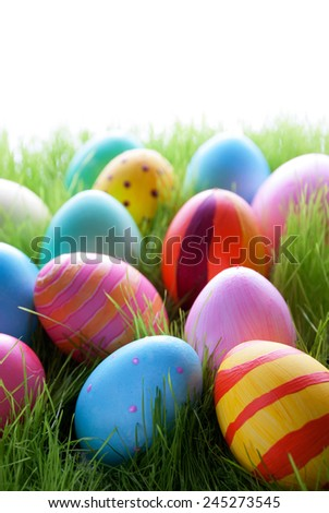 Many Colorful Easter Eggs On Sunny Green Grass For Easter Or Seasons Greetings Eggs In Different Colors - stock photo