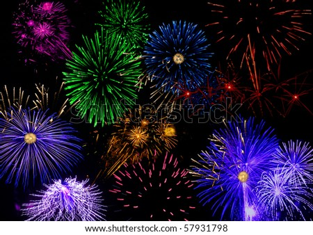 Many colorful fireworks in a black sky.