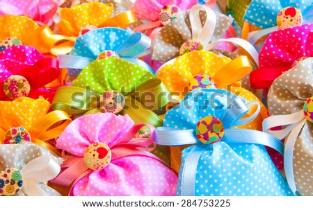Many colorful gift bags with bow - stock photo