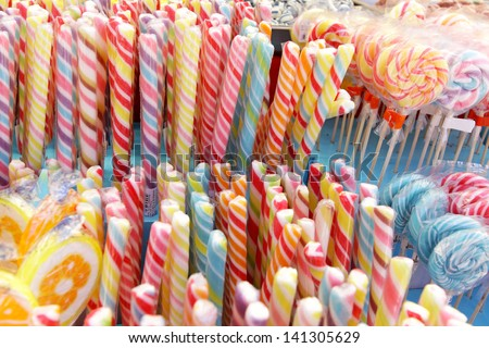 Many colorful Halloween sweets and candy filling background - stock photo