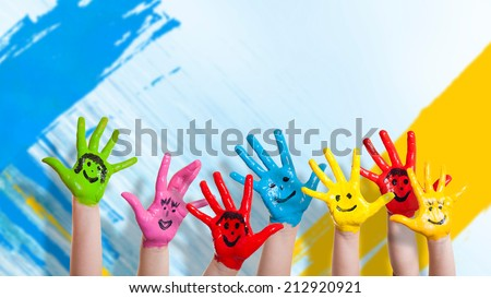 many colorful hands with smileys  - stock photo