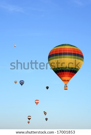Many colorful hot air balloons in the blue sky. - stock photo