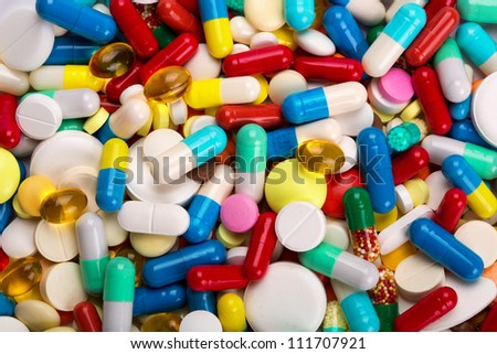 Many colorful medicines. Background or texture - stock photo