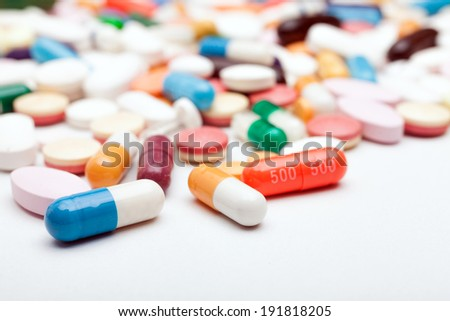 Many colorful medicines. Pills and capsules on white background - stock photo