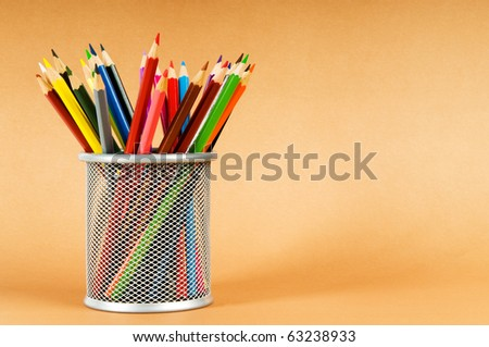 Many colorful pencils on the color background