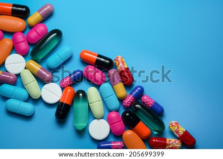 Many colorful pills  - stock photo