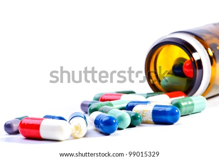 Many colorful pills isolated on white - stock photo