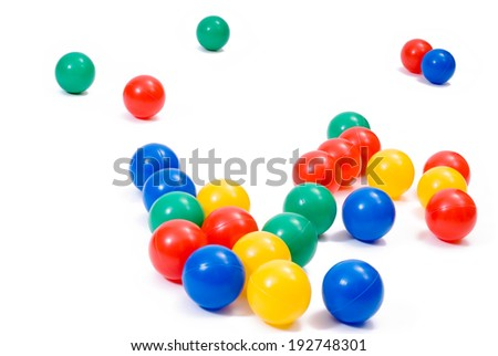 Many colorful plastic toy balls on white - stock photo