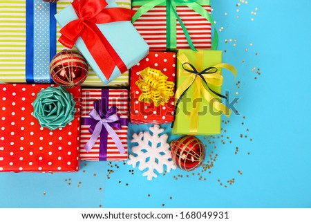 Many colorful presents with luxury ribbons  on color  background - stock photo