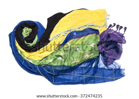 Many colorful scarf made wave pattern isolated white.