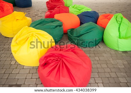 stock-photo-many-colorful-soft-beanbag-seats-under-a-canopy-for-relaxing-434038399