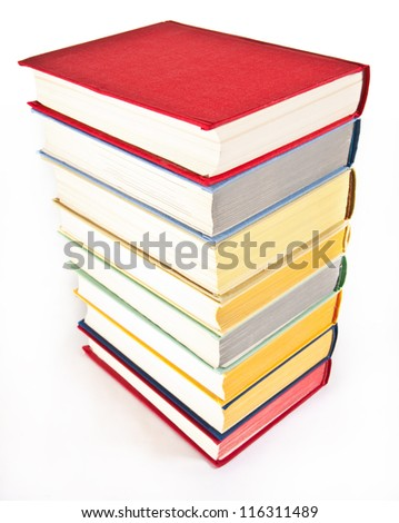 Many colorful stacked books on neutral background