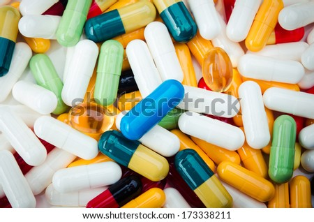 many colorful tables and pills. top view