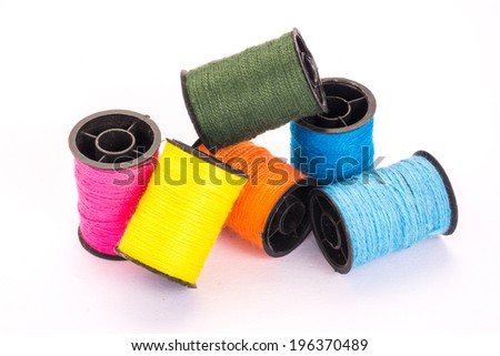 Many colorful threads, isolated white background.
