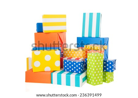 Many colorful wrapped presents isolated over white background - stock photo