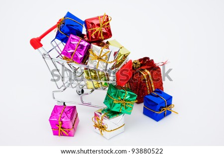 Many colors of christmas gifts in a shopping cart isolated on white background. - stock photo