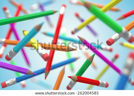 Many colour pencils chaotically flying in air - stock photo