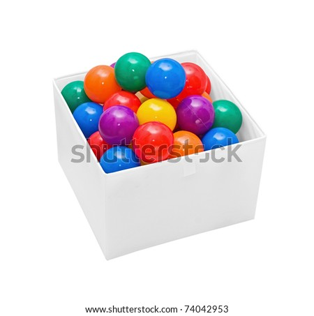 Many colour plastic balls in box on white - stock photo