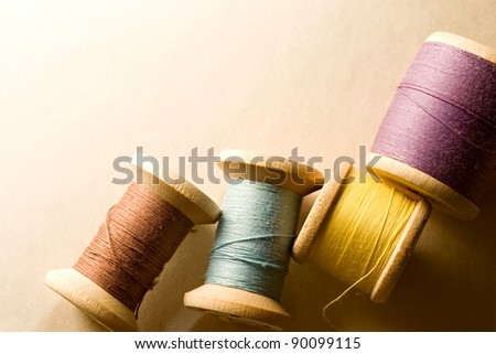 Many-coloured wooden bobbins - stock photo
