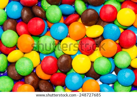 Many colourfull chocolate candy dots for the background - stock photo