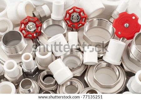 many combined fittings for metal and PVC pipes, unions and valves - stock photo