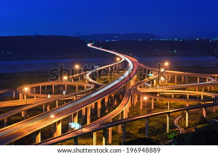 Many connecting highway bridges with mountains in the distance. - stock photo