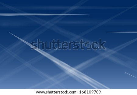 Many contrails of airplanes in the blue sky, that pollute the air and promotes global warming. - stock photo