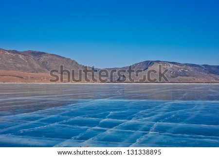 many cracks in the ice - stock photo