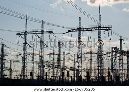 Many crossing electric power transmission lines - stock photo
