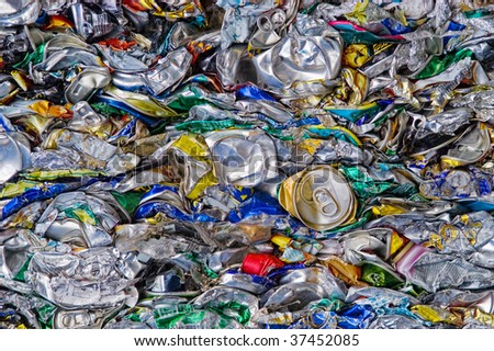 Many crushed soda cans on a scrapyard - stock photo