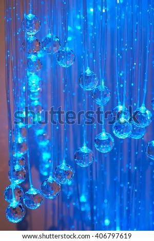many crystal balls , lit in multicolored light,  illuminated, background    - stock photo