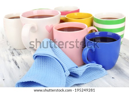 Many cups of coffee on wooden table close up - stock photo