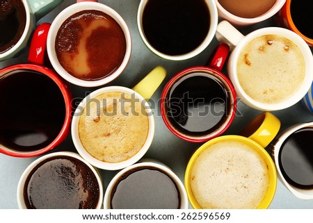 Many cups of coffee, top view - stock photo