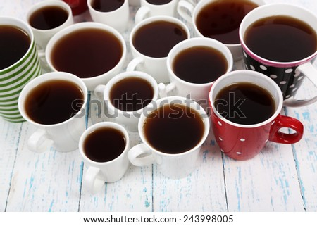 Many cups of tea on table close-up - stock photo