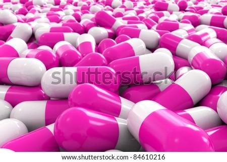 many 3d pink pills - stock photo