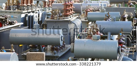 many decommissioned transformers of substations - stock photo